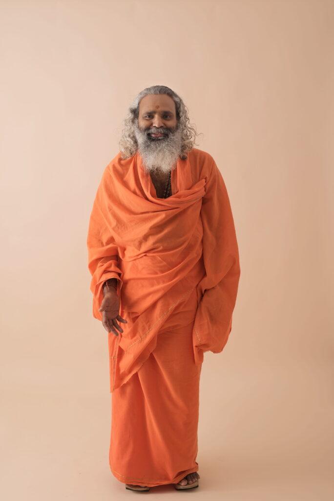 An old man with an orange garment